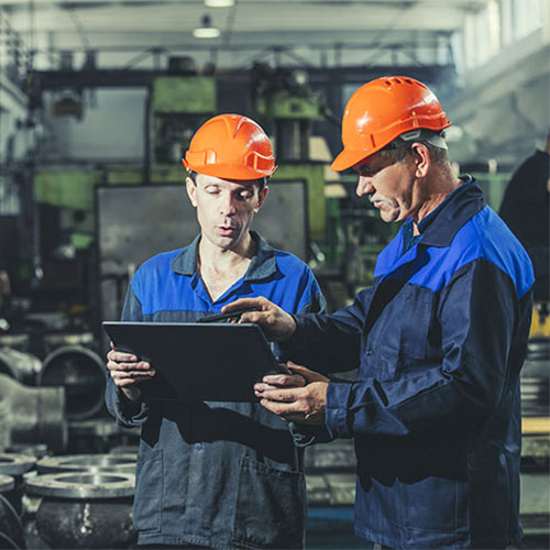 Two men standing in an industrial facility