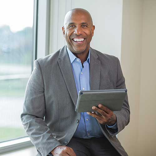 Executive holding a tablet computer