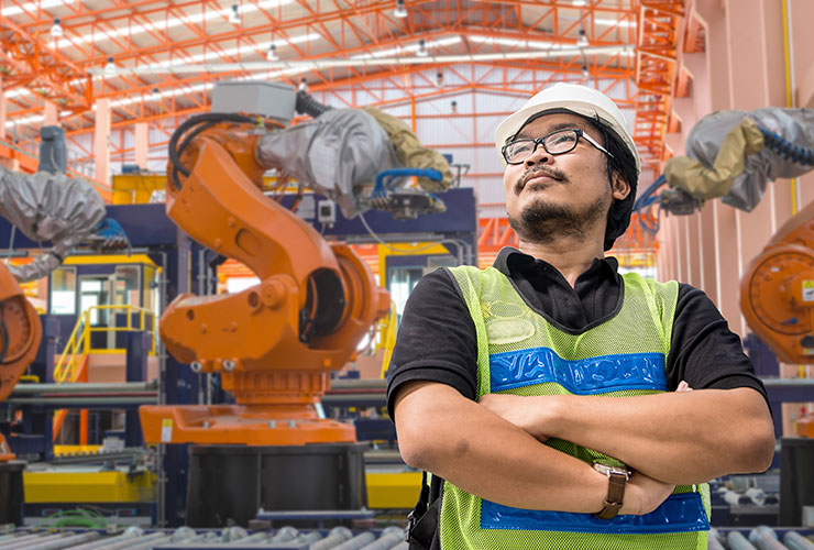Man in a manufacturing plant with IoT capabilities.