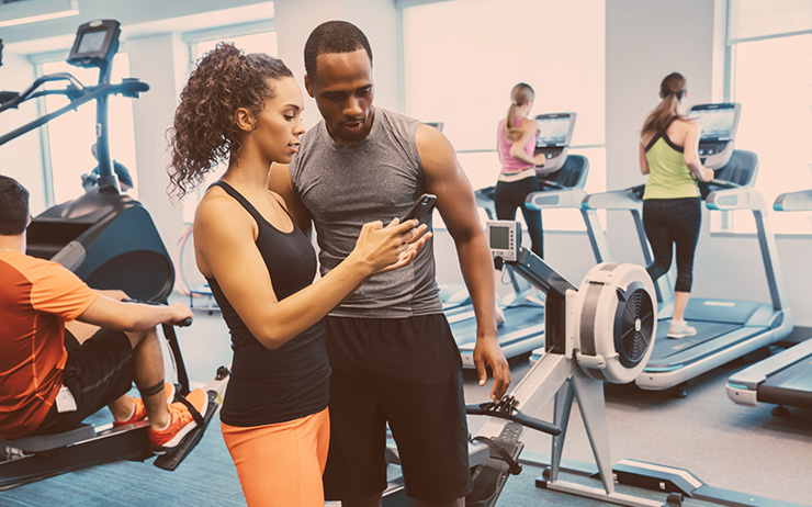 Couple reviewing health data at the gym
