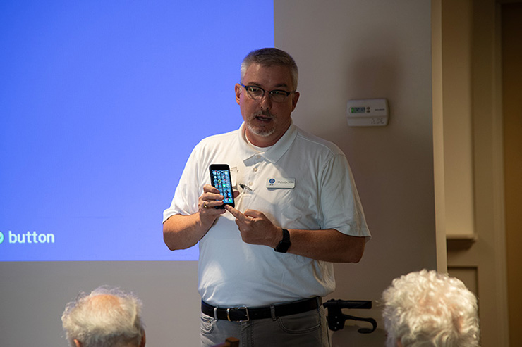 Malcolm Wills, Board Chair and Interim Executive Director of BH Tech Group, leads a session teaching seniors how to use their smartphones, tablets and other technology.