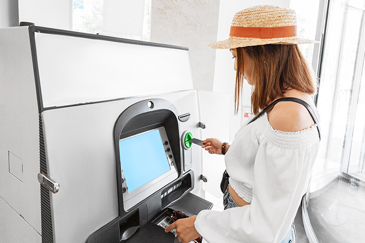 Woman at ATM machine